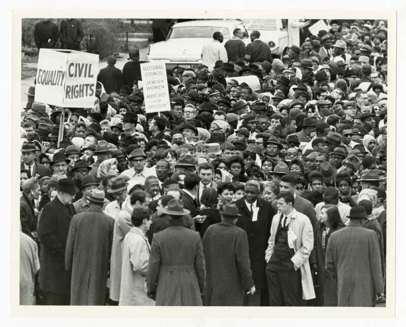 Crowd of marching protestors, Jackie Robinson standing center-right