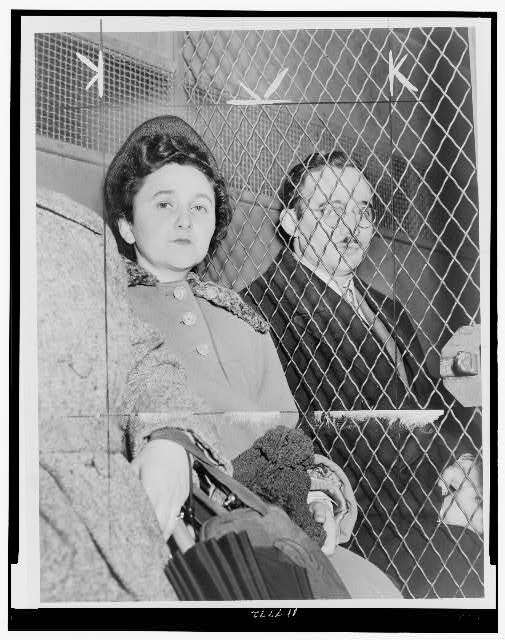 Julius and Ethel Rosenberg, separated by heavy wire screen as they leave U.S. Court House after being found guilty by jury / World Telegram photo by Roger Higgins